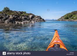 sea kayaking in clear waters off coast