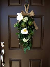 magnolia and artichoke front door swag burlap bow wreath