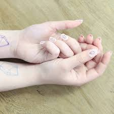 geometric crystal nail tattoos by sparrow and wolf