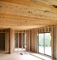 studs and ceiling rafter beams installed in shipping