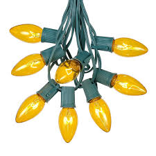 Yellow C9 Lights Yellow C9 Outdoor String Light Set On Green Wire Novelty Lights Inc