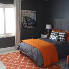 stylish orange and dark gray bedding to cover gray painted kids