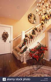 Home Decorated For Christmas by Front Hall And Staircase Of American Home Decorated For The