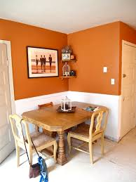 orange walls with white wainscoting try