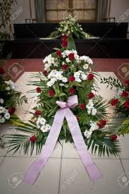 funeral ribbon large funeral flowers in wreath with ribbon on floor stock photo
