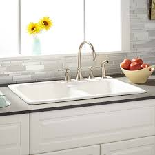 white kitchen sink faucets 33 elgin 60 40 white bowl cast iron drop in kitchen sink