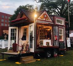 tiny fire house made from fire truck parts used as mobile tribute home