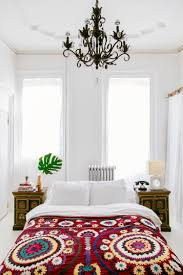 suzani and wrought iron chandelier matching vintage nightstands