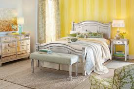 mirror mixed wooden bed frame in beige color scheme having curved