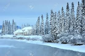 alaska house house on an alaska river in winter stock photo picture and
