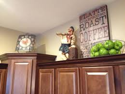 Above Kitchen Cabinets by 25 Best Top Of Cabinets Ideas On Pinterest Above Cabinet Decor