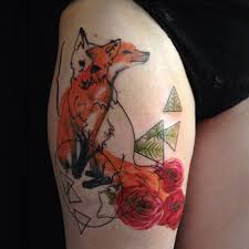 unique animated fox with roses tattoo on thigh