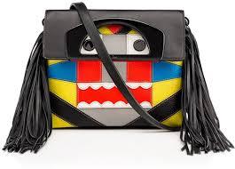 christian louboutin tribalou handbag collection pursuitist