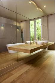 Mirror Wall In Bathroom Contemporary Bathroom Dressed In Woods A Wall Of Mirrors