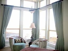 high ceiling living room design ideas with long curtains and warm