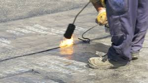 drainage of building foundation worker using gas burner to weld