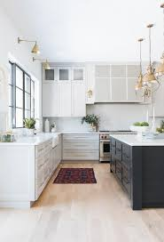 grey kitchen cabinets wood floor light wood floors with light gray kitchen cabinets