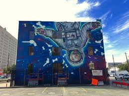 new mural pays homage to space city with cosmic canine houston 1 5