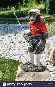 monkey plays golf statue as backyard decor stock photo royalty