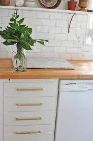 simple design of kitchen with oak wooden butcher block countertops
