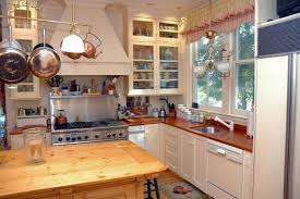 Under Cabinet Pot Rack by Kitchen Exposed Log Beam Ceiling Also Overhead Cast Iron Pot Rack