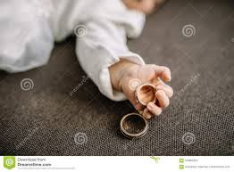 baby hand rings images Baby hand holding gold wedding ring stock photo image of born jpg