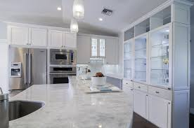 kitchen classic quartzite with cabinets and pendant