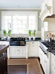 black kitchen countertops with white cabinets pairing countertops with light cabinets for a