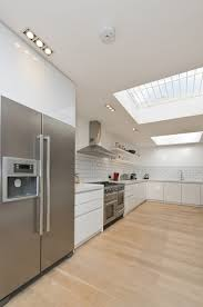 gray island and cabinet plus sofa window backsplash skylight dark