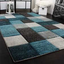 tappeti design moderni tappeto design moderno lavorato a mano con bordo a quadri turchese
