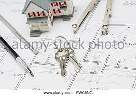 Model Home Plans Engineer Pencil Ruler And Keys Resting On Custom House Plans