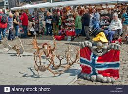 Flea Market Flags Reindeer Antlers And A Model Troll With The Norwegian Flag On Sale