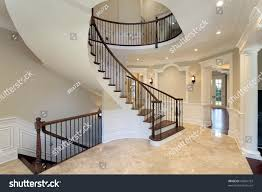 foyer new construction home curved staircase stock photo 45681793