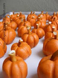 peanut butter pumpkins with a pretzel stem so cute and so