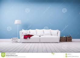 sofa and floor lamp at blue wall stock photo image 53863415