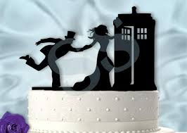 dr who cake topper pulling groom into tardis dr who inspired wedding cake