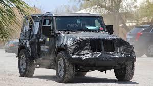 jeep truck 2018 spy photos 2018 jeep wrangler hides evolutionary design underneath thick camo