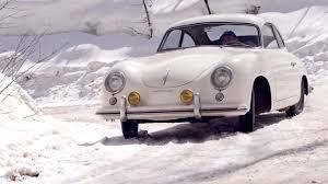 old porsche 356 sliding a classic porsche 356 in the snow because you can