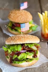 French And American Flags Two Hamburger With American Flag On Top French Fries And Tomato