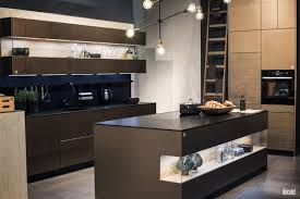 brown wall mounted cabinets open shelves black countertop and