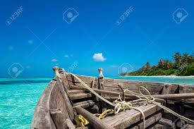 tropical island paradise perfect tropical island paradise beach and old boat stock photo