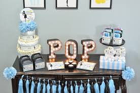 ready to pop blue baby shower favor table candles and favors