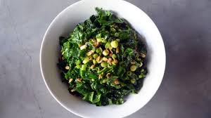 kale salad with glazed sunflower seeds and cider vinaigrette