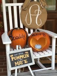 baby shower halloween theme fall baby announcement with a baby blue painted pumpkin for a boy