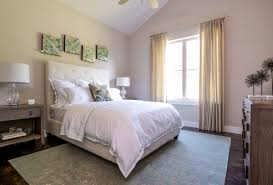 a transitional style bedroom that would make any guest feel