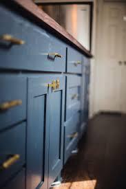 navy blue kitchen cabinets with brass hardware white kitchen with navy blue island home bunch interior