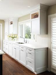 granite countertop beechwood cabinets tile backsplash photos two