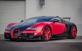 bugatti veyron supersport red and black bugatti veyron super sport in grey walls picture
