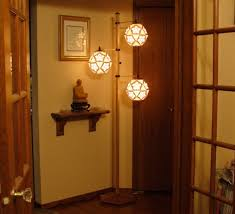 paper lantern style floor lamp natural wood with three moving