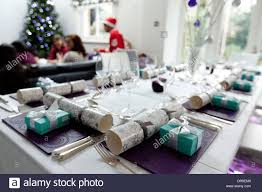 christmas dinner table set for christmas with decorations and